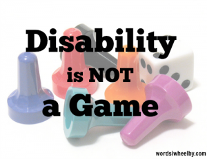 "Black text reads ""disability is not a game."" It is superimposed over multicolored game pieces and a game die."