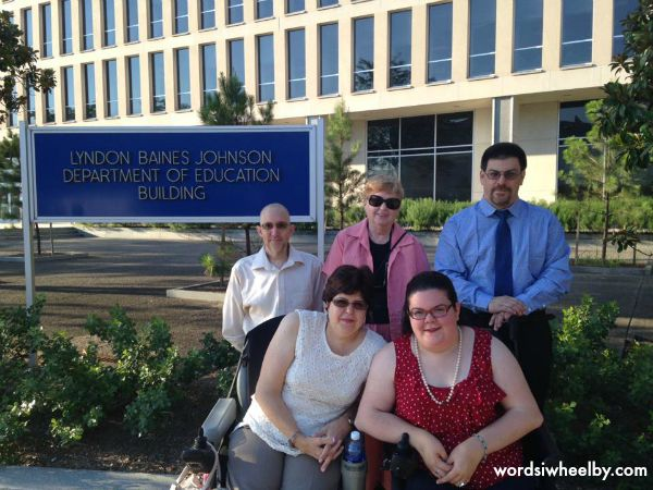 Family in front of Lyndon Baines Johnson Department of Education Building - Words I Wheel By