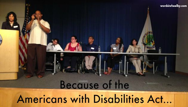Photo of Commissioner Janet LaBreck at podium with panel of disability activists seated at a table on a stage with royal blue curtains at the U.S. Department of Education - Words I Wheel By