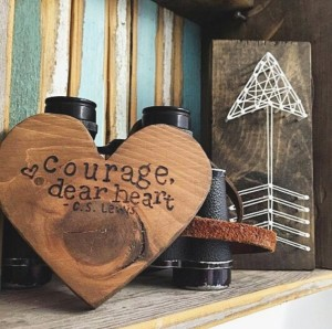 "Wood Burned Hearts by Soulmade Goods that reads ""Courage, dear heart."" - C.S. Lewis"